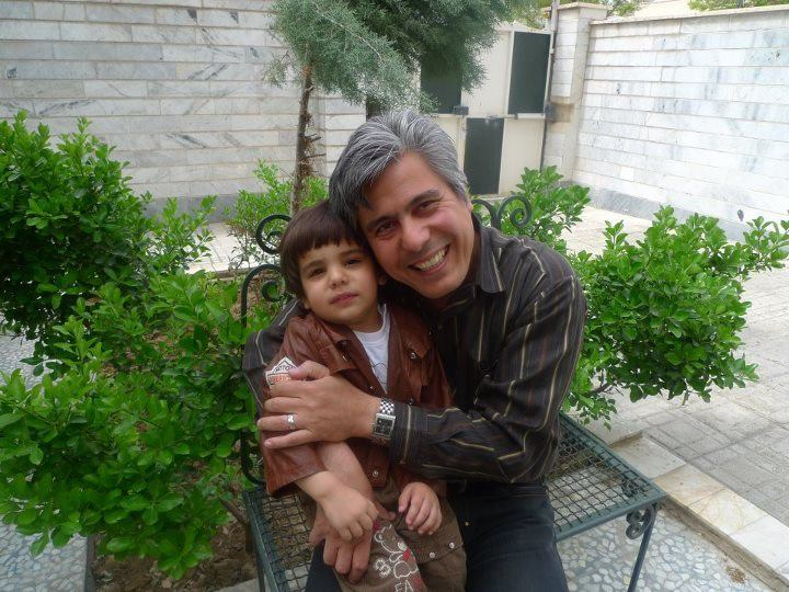 Pastor Behnam Irani with his son.